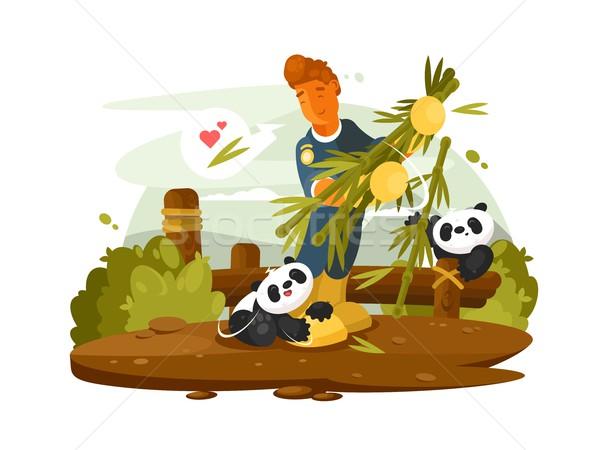 Zoo worker feeds cute pandas Stock photo © jossdiim