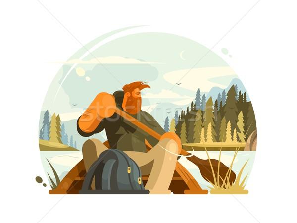 Barbuto uomo canoa barca lago legno Foto d'archivio © jossdiim