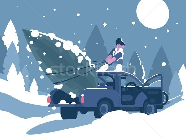 Man loading Christmas tree in car Stock photo © jossdiim