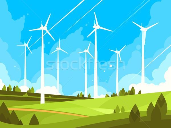 Windmills on green fields Stock photo © jossdiim