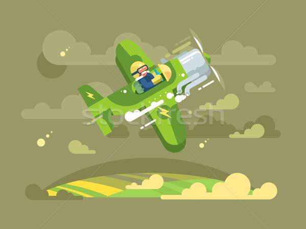 Pilot flying on airplane in sky Stock photo © jossdiim