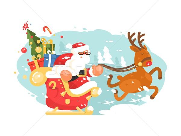 Santa Claus rides in sleigh Stock photo © jossdiim