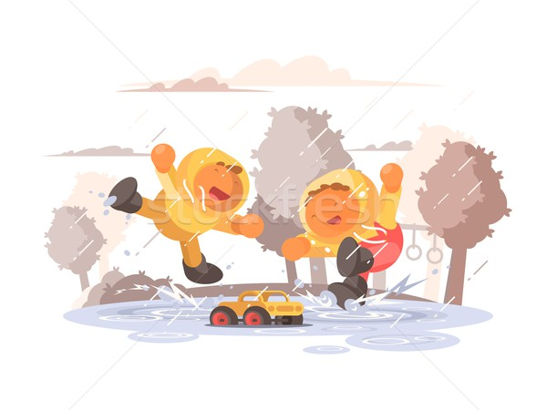Happy children jumping in puddle Stock photo © jossdiim