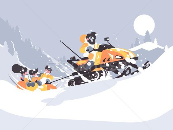 Man on snowmobile drives children Stock photo © jossdiim