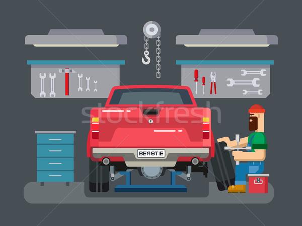 Mechanic Repairs Car in the Garage Stock photo © jossdiim