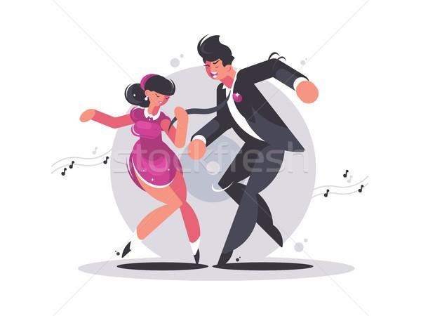 Happy couple of guy and girl dancing Stock photo © jossdiim