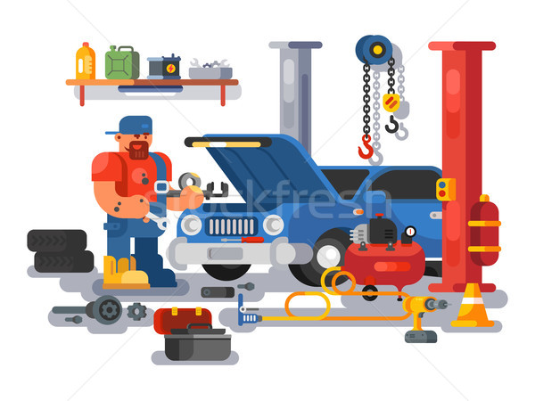 Mechanic worker repairs car in garage Stock photo © jossdiim