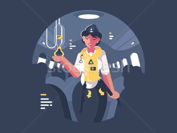 Stewardess explains safety on board aircraft Stock photo © jossdiim