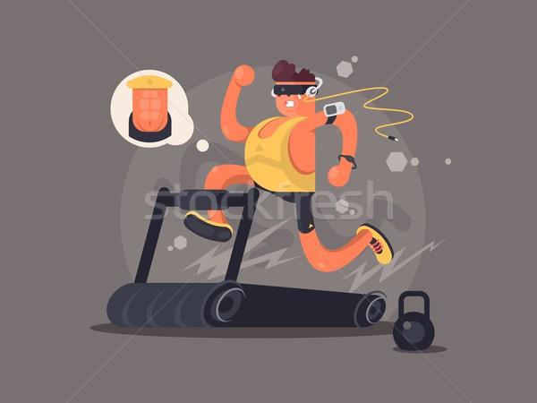 Stock photo: Young man running on treadmill