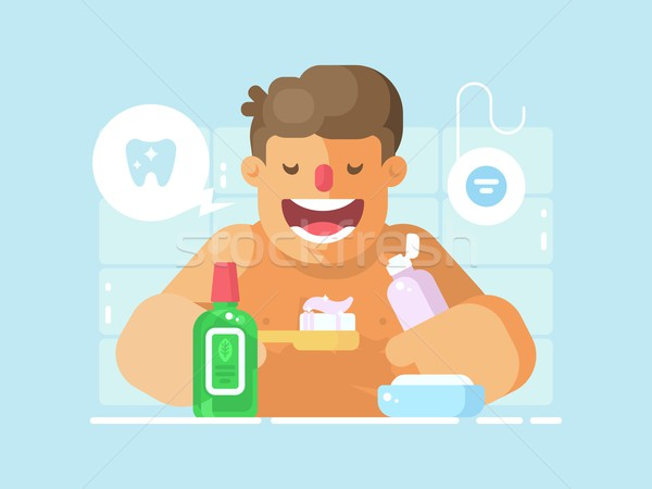 Young guy brushing teeth with whitening paste Stock photo © jossdiim