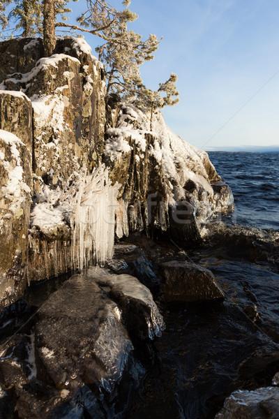 Frozen lakefront rock cliff  Stock photo © Juhku