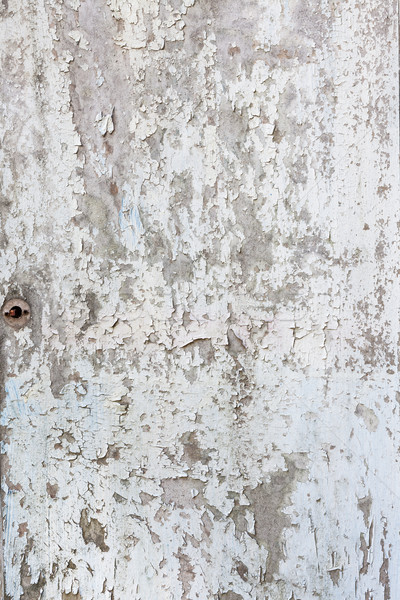 Old paint peeling from white door Stock photo © Juhku