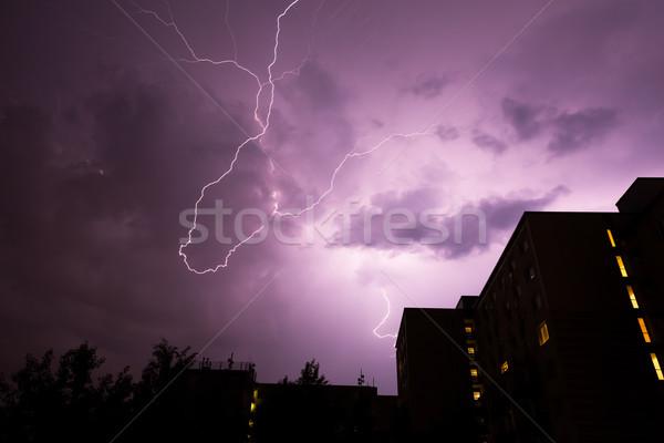 Villám épületek városi ház eső éjszaka Stock fotó © Juhku