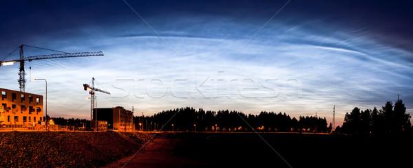 Noctilucent clouds glowing at night sky panorama Stock photo © Juhku