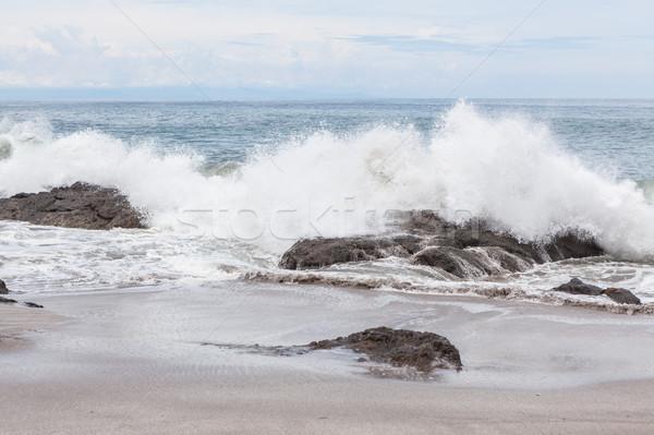 Waves crashing to rocks montezuma beach Stock photo © Juhku