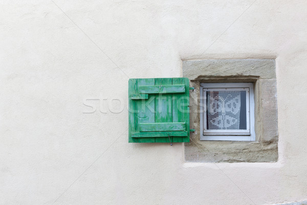 Small window and wooden shutter Stock photo © Juhku