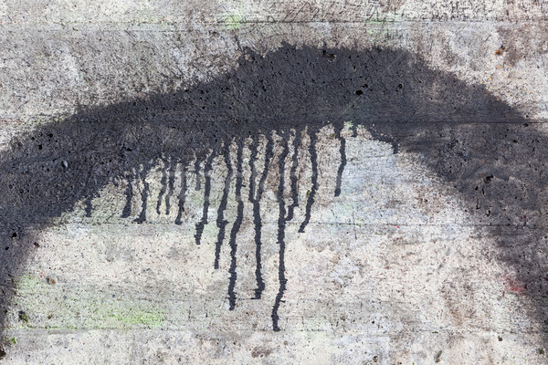 Concrete wall texture and black paint dripping Stock photo © Juhku
