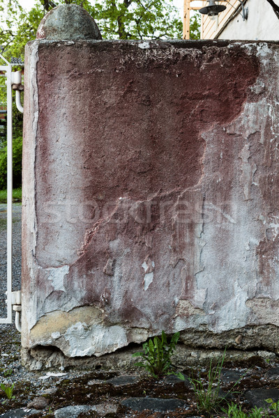 Broken concrete wall and faded red paint Stock photo © Juhku