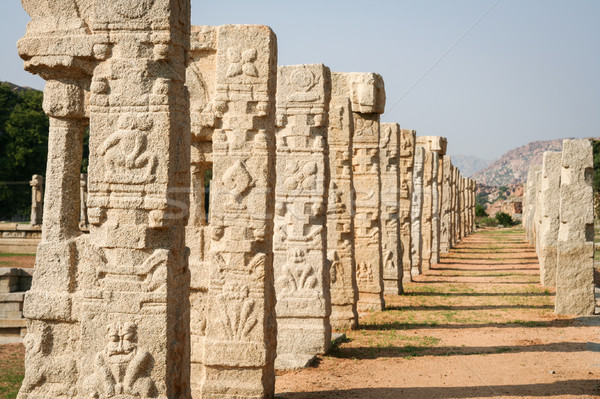 Pillars of ruined temple in hampi Stock photo © Juhku