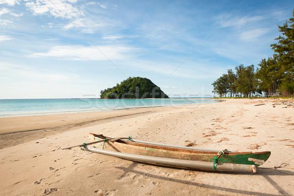 Small fishing boat exotic beach Stock photo © Juhku