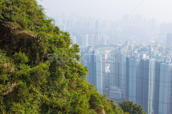 Hongkong magas épületek pára zöld domboldal Stock fotó © Juhku
