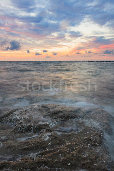 Long exposure sea and rocks at twilight Stock photo © Juhku