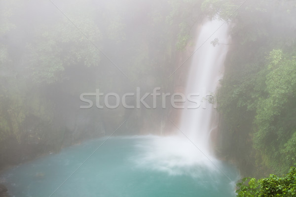 Rio celeste waterfall at foggy day Stock photo © Juhku