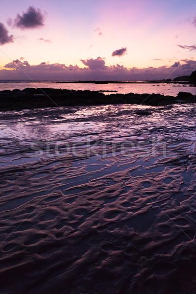 Stock photo: Beautiful rock patterns and sunrise at shore