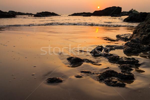 Sunset at om beach india Stock photo © Juhku