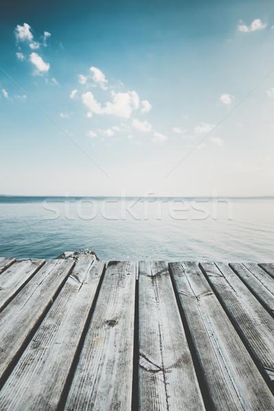 безмятежный мнение пирс озеро пляж небе Сток-фото © Juhku