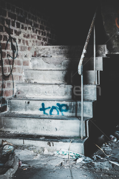 Creepy staircase in abandoned warehouse Stock photo © Juhku
