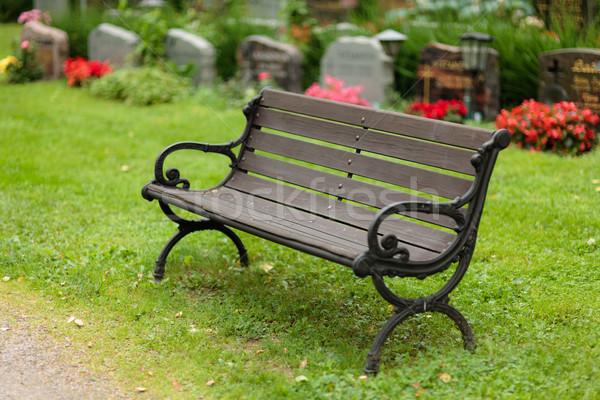 пусто старые скамейке кладбище цветы Сток-фото © Juhku
