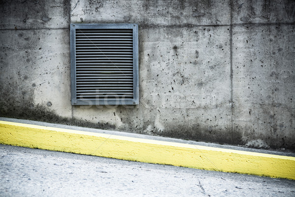 Grunge concrete wall and air ventilation duct Stock photo © Juhku