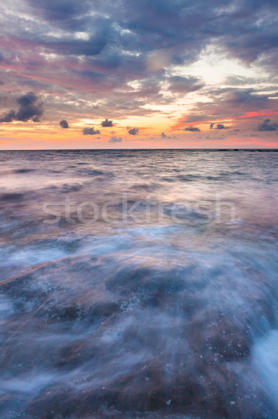 Long exposure sea and rocks at twilight Stock photo © Juhku