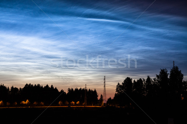 Noctilucent clouds glowing at night sky Stock photo © Juhku