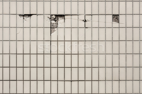 Tile wall where some tiles cracked Stock photo © Juhku