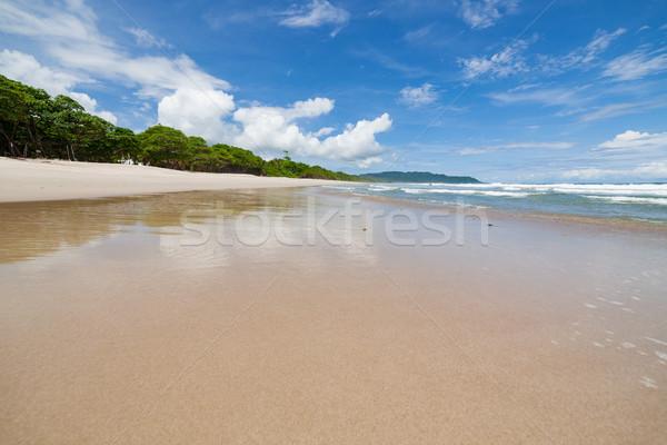 Golven zand strand wolken Stockfoto © Juhku