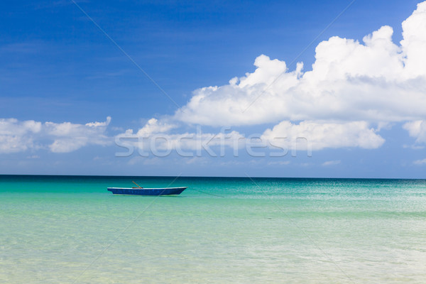 Rybak łodzi turkus wody dzień tle Zdjęcia stock © Juhku