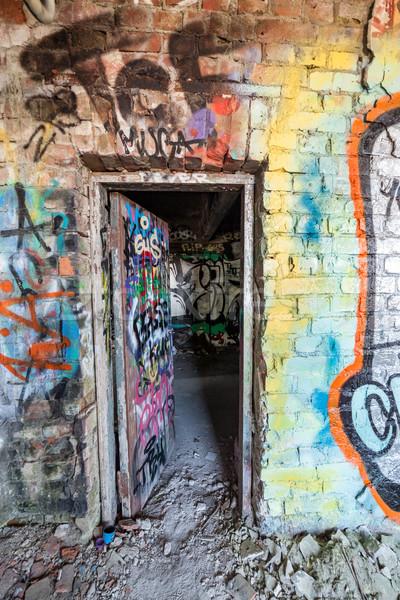 Nyitott ajtó elhagyatott gyár koszos építkezés fal Stock fotó © Juhku