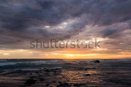 Mar olas puesta de sol luz brillo nublado Foto stock © Juhku