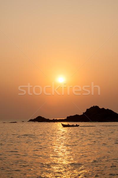 Rocky island silhouette and sunset Stock photo © Juhku