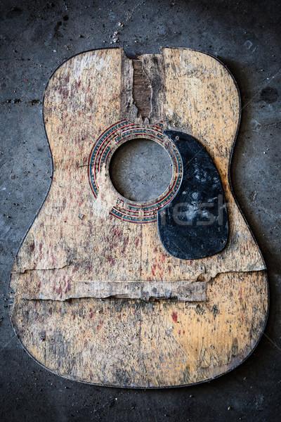 Stock photo: Broken acoustic guitar