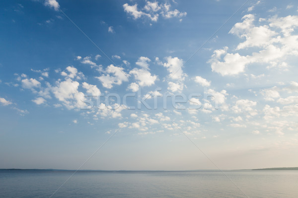 Tranquil lake scene at sunrise Stock photo © Juhku