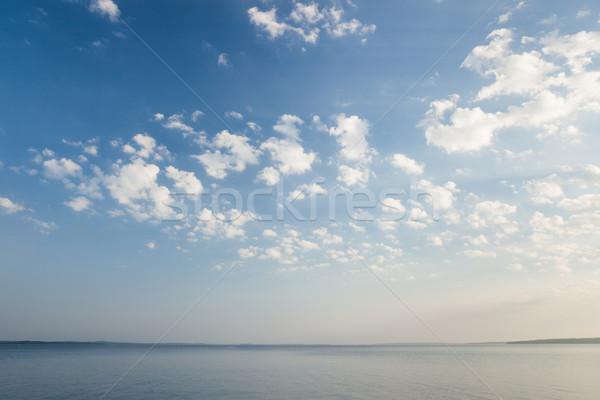 Nyugalmas tó jelenet napfelkelte felhők tengerpart Stock fotó © Juhku