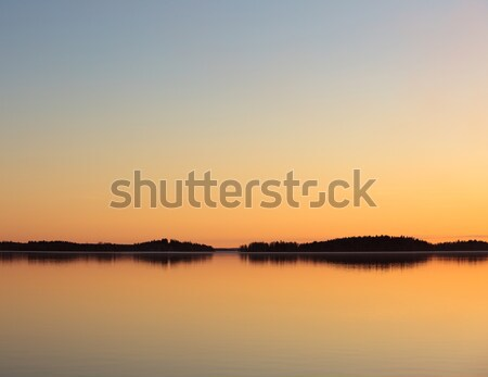 Serene lake view at dusk Stock photo © Juhku