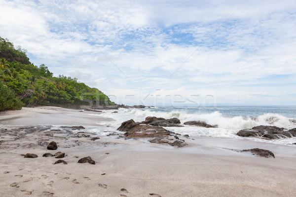 Ondas rochas praia Costa Rica céu mar Foto stock © Juhku