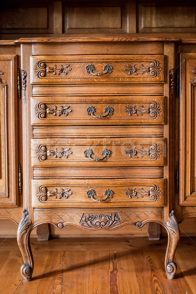 Stock photo: Antique wood carved chest of drawers