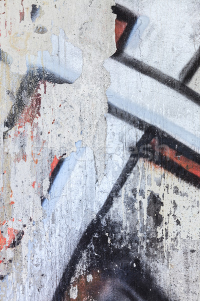 Stock photo: Gaffiti closeup in a damaged concrete wall