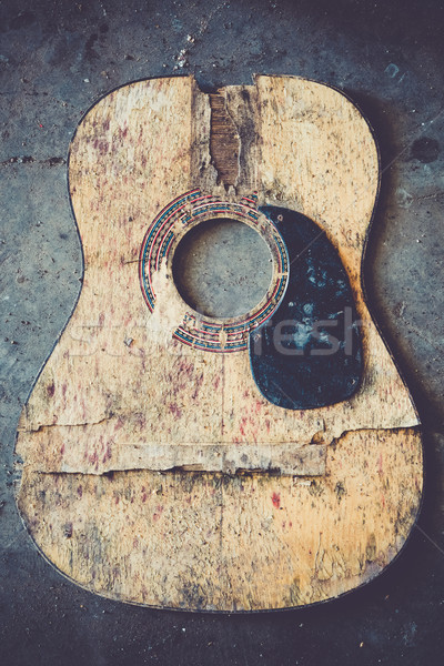 Stock photo: Broken acoustic guitar