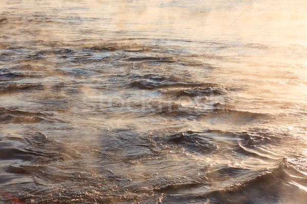 Water vapor on surface of cold water Stock photo © Juhku